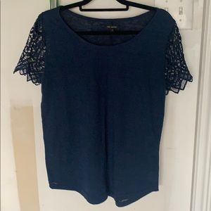 Soft blue blouse with decorated sleeves